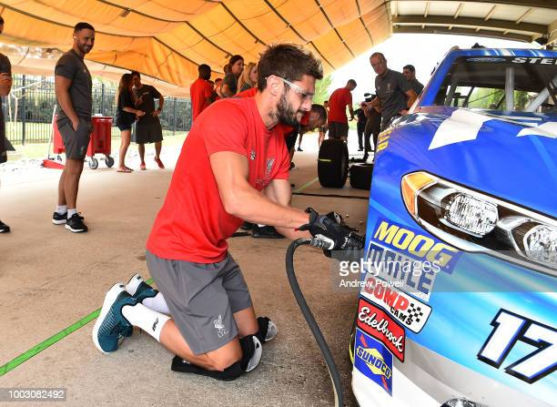 Adam Lallana of Liverpool changing tyres during a tour of Roush Fenway Racing on July 21 2018 in Charlotte North Carolina