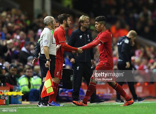 Adam Lallana of Liverpool comes on for Roberto Firmino of Liverpool during the Capital One Cup Fourth Round match between Liverpool and AFC...