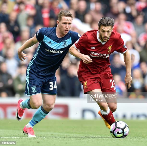 Adam Lallana of Liverpool competes with Adam Forshaw of Middlesbrough during the Premier League match between Liverpool FC and Middlesbrough FC at...