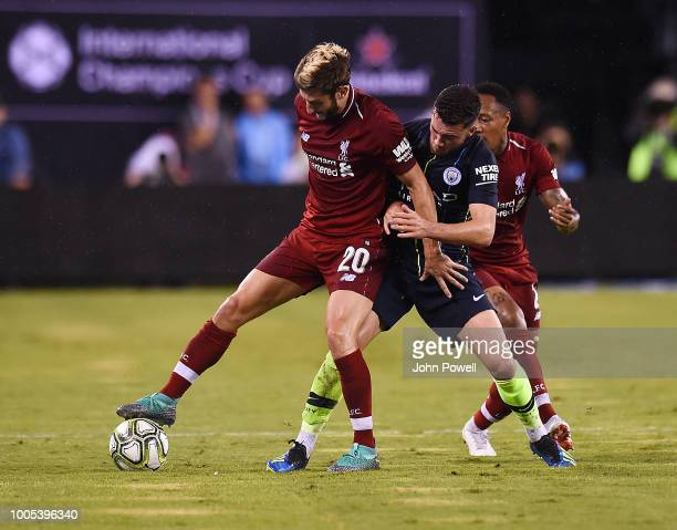 Adam Lallana of Liverpool competes with Jack Harrison of Manchester City dejected during the International Champions Cup 2018 match between...
