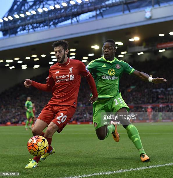 Adam Lallana of Liverpool competes with Lamine Kone of Sunderland during the Barclays Premier League match between Liverpool and Sunderland at...
