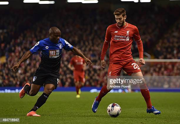 Adam Lallana of Liverpool competes with Tokelo Rantie of AFC Bournemouth during the Capital One Cup Fourth Round match between Liverpool and AFC...