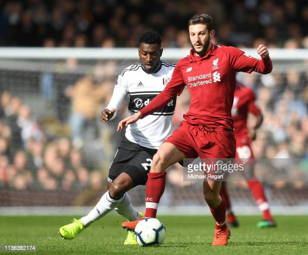 Adam Lallana of Liverpool controls the ball as AndreFrank Zambo Anguissa of Fulham chases during the Premier League match between Fulham FC and...