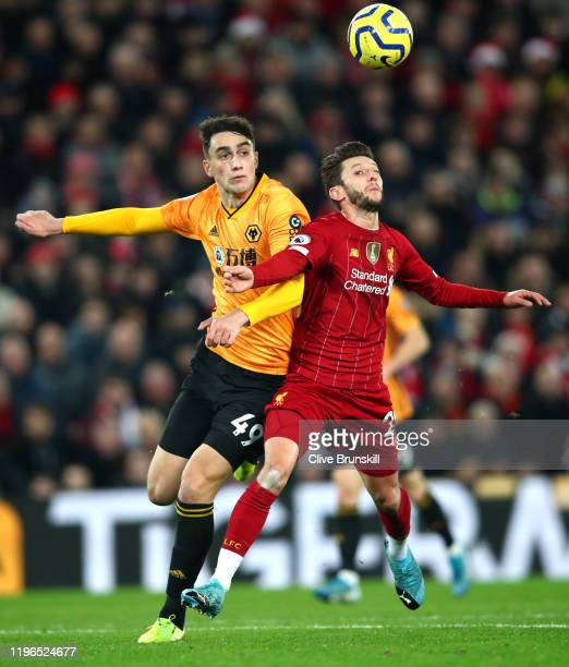 Adam Lallana of Liverpool controls the ball under pressure from Maximilin Kilman of Wolverhampton Wanderers leading to Liverpools first goal scored...