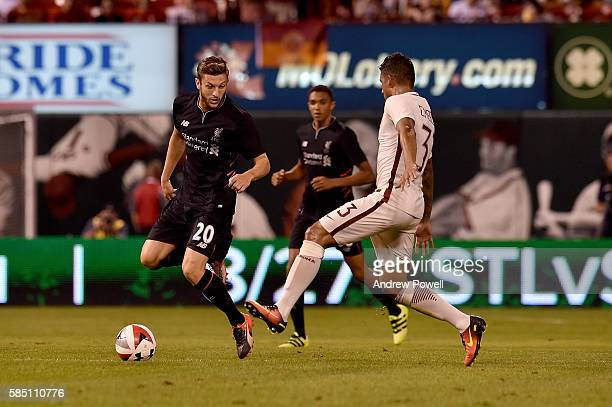 Adam Lallana of Liverpool FC and Emerson Palmieri of AS Roma vie for control of the ball during a preseason friendly at Busch Stadium on August 1...
