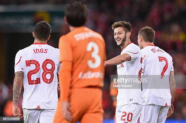 Adam Lallana of Liverpool FC celebrates kicking a goal with team mates during the international friendly match between Brisbane Roar and Liverpool FC...