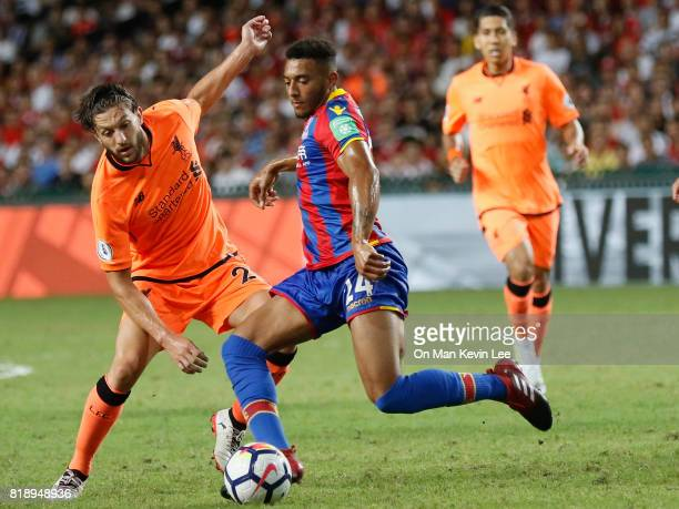 Adam Lallana of Liverpool FC competes for the ball with Keshi Anderson of Crystal Palace FC during the Premier League Asia Trophy match between...