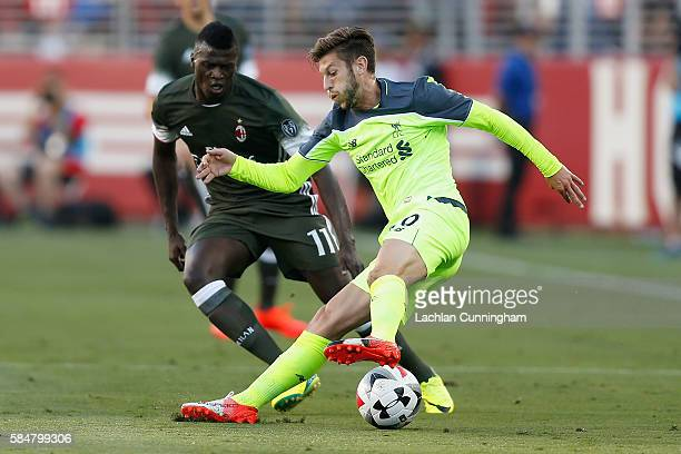 Adam Lallana of Liverpool FC evades a tackle from M'Baye Niang of AC Milan during the International Champions Cup match at Levi's Stadium on July 30...