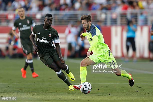 Adam Lallana of Liverpool FC evades M'Baye Niang of AC Milan during the International Champions Cup match at Levi's Stadium on July 30 2016 in Santa...