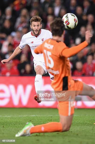 Adam Lallana of Liverpool FC kicks a goal during the international friendly match between Brisbane Roar and Liverpool FC at Suncorp Stadium on July...
