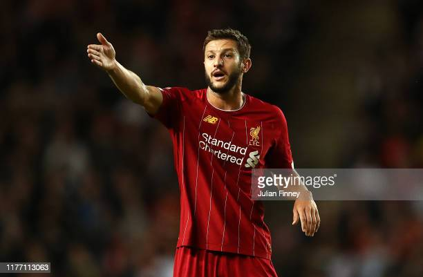 Adam Lallana of Liverpool gives instructions during the Carabao Cup Third Round match between MK Dons and Liverpool at Stadium mk on September 25,...