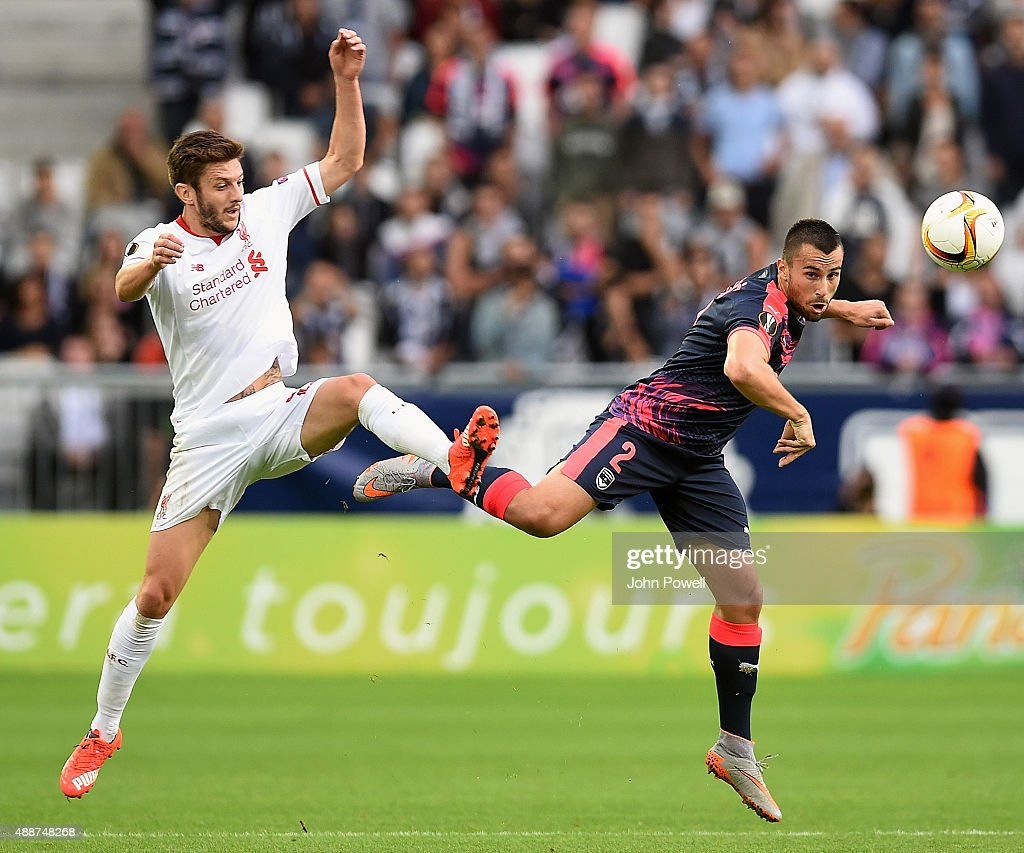 Adam Lallana of Liverpool goes up with Milan gajic of FC Girondins de Bordeaux during the UEFA Europa League match between FC Girondins de Bordeaux and Liverpool FC on September 17, 2015 in Bordeaux, France.