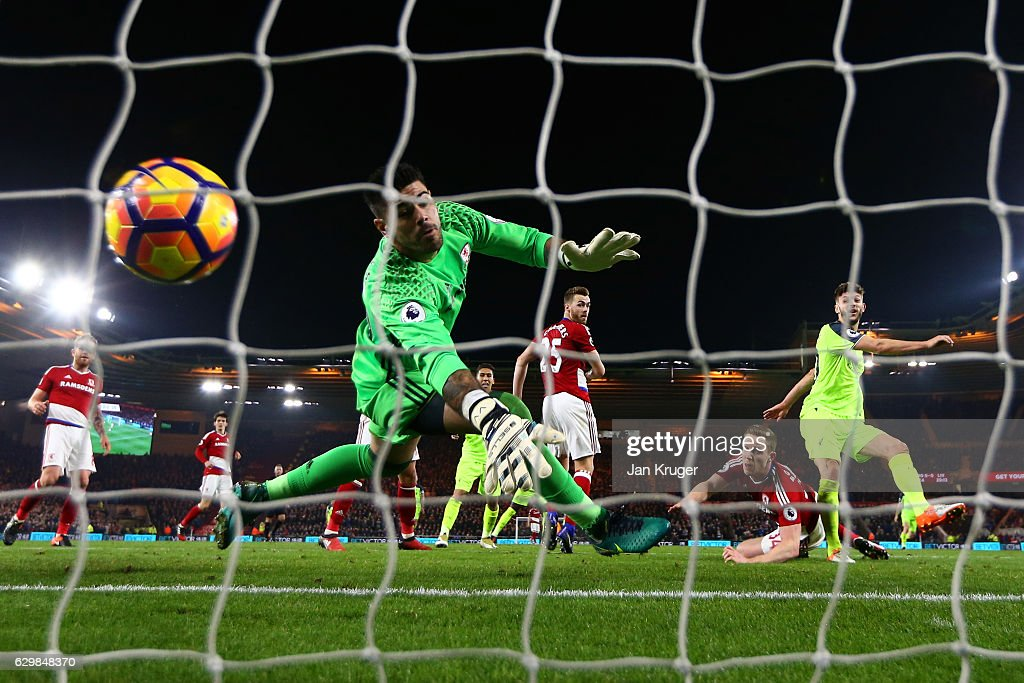 Adam Lallana (1st R) of Liverpool heads to score the opening goal past Victor Valdes of Middlesbrough during the Premier League match between Middlesbrough and Liverpool at Riverside Stadium on December 14, 2016 in Middlesbrough, England.