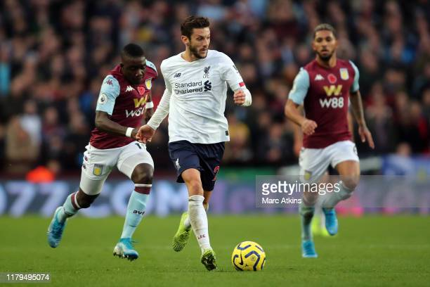 Adam Lallana of Liverpool in action with Marvelous Nakamba of Aston Villa during the Premier League match between Aston Villa and Liverpool FC at...
