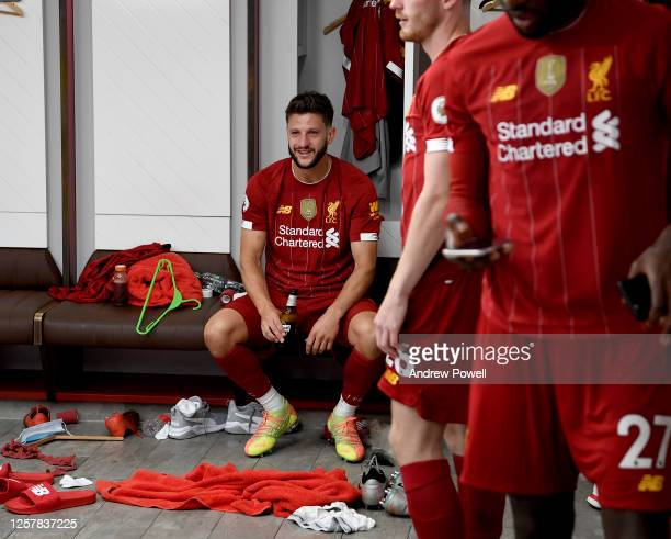 Adam Lallana of Liverpool in the dressing room after winning the Premier league at the end of the Premier League match between Liverpool FC and...