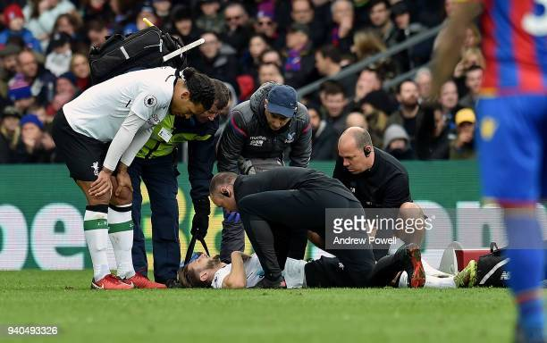 Adam Lallana of Liverpool injured during the Premier League match between Crystal Palace and Liverpool at Selhurst Park on March 31 2018 in London...