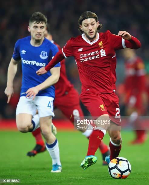 Adam Lallana of Liverpool is watched by Jonjoe Kenny of Everton during the Emirates FA Cup Third Round match between Liverpool and Everton at Anfield...