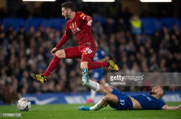 Adam Lallana of Liverpool jumps over a tackle from Mateo Kovacic of Chelsea during the FA Cup Fifth Round match between Chelsea FC and Liverpool FC...
