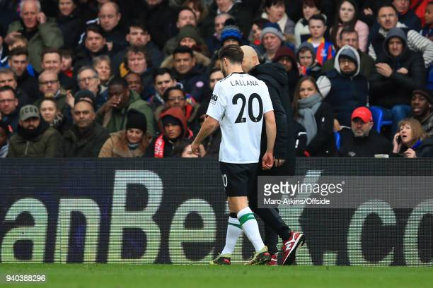 Adam Lallana of Liverpool leaves the game with an injury during the Premier League match between Crystal Palace and Liverpool at Selhurst Park on...