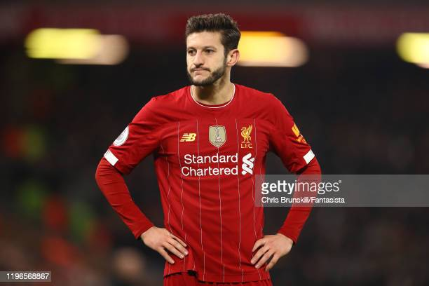 Adam Lallana of Liverpool looks on during the Premier League match between Liverpool FC and Wolverhampton Wanderers at Anfield on December 29 2019 in...