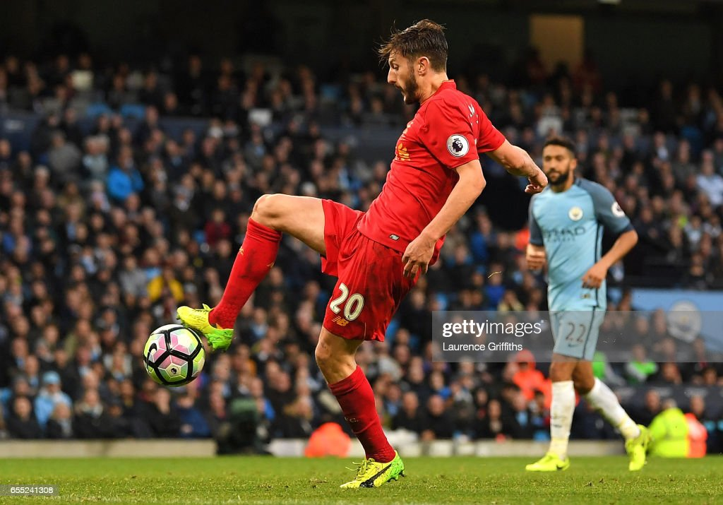 Adam Lallana of Liverpool misses a chance to score during the Premier League match between Manchester City and Liverpool at Etihad Stadium on March 19, 2017 in Manchester, England.