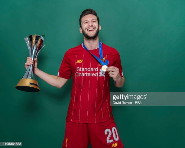 Adam Lallana of Liverpool poses with the Club World Cup trophy after the FIFA Club World Cup Qatar 2019 Final match between Liverpool and CR Flamengo...