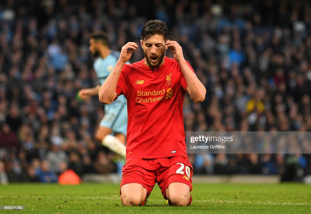 Adam Lallana of Liverpool reacts after missing a chance to score during the Premier League match between Manchester City and Liverpool at Etihad Stadium on March 19, 2017 in Manchester, England.