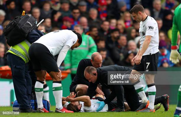 Adam Lallana of Liverpool recieves medical treatment during the Premier League match between Crystal Palace and Liverpool at Selhurst Park on March...