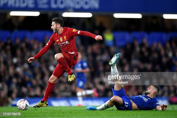Adam Lallana of Liverpool rides a tackle from Mateo Kovacic of Chelsea during the FA Cup Fifth Round match between Chelsea FC and Liverpool FC at...