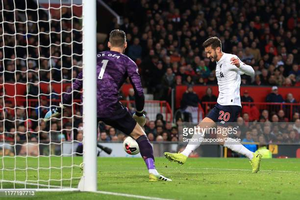 Adam Lallana of Liverpool scores an equalising goal to bring the score level at 11 during the Premier League match between Manchester United and...