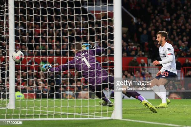 Adam Lallana of Liverpool scores an equalising goal to bring the score level at 1-1 during the Premier League match between Manchester United and...