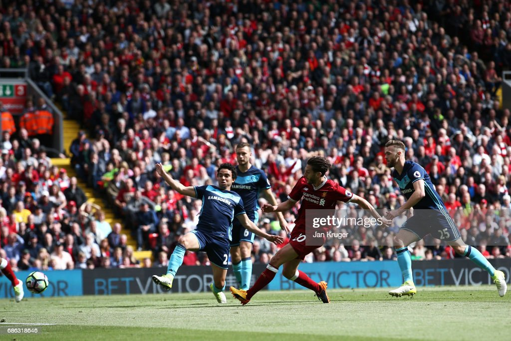 Adam Lallana of Liverpool scores his sides third goal during the Premier League match between Liverpool and Middlesbrough at Anfield on May 21, 2017 in Liverpool, England.