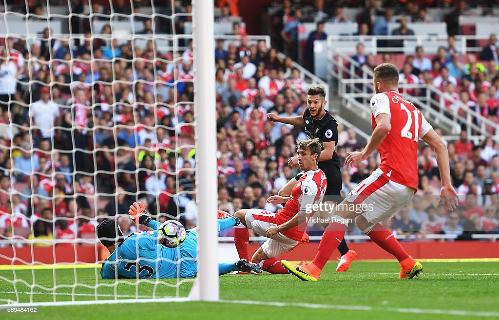 Adam Lallana of Liverpool scores his team's second goal during the Premier League match between Arsenal and Liverpool at Emirates Stadium on August 14, 2016 in London, England.