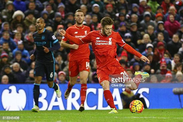 Adam Lallana of Liverpool scores the opening goal during the Barclays Premier League match between Liverpool and Manchester City at Anfield on March...