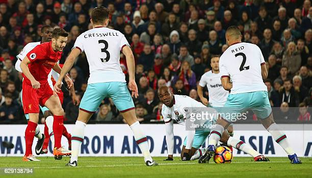 Adam Lallana of Liverpool scores the opening goal during the Premier League match between Liverpool and West Ham United at Anfield on December 11...