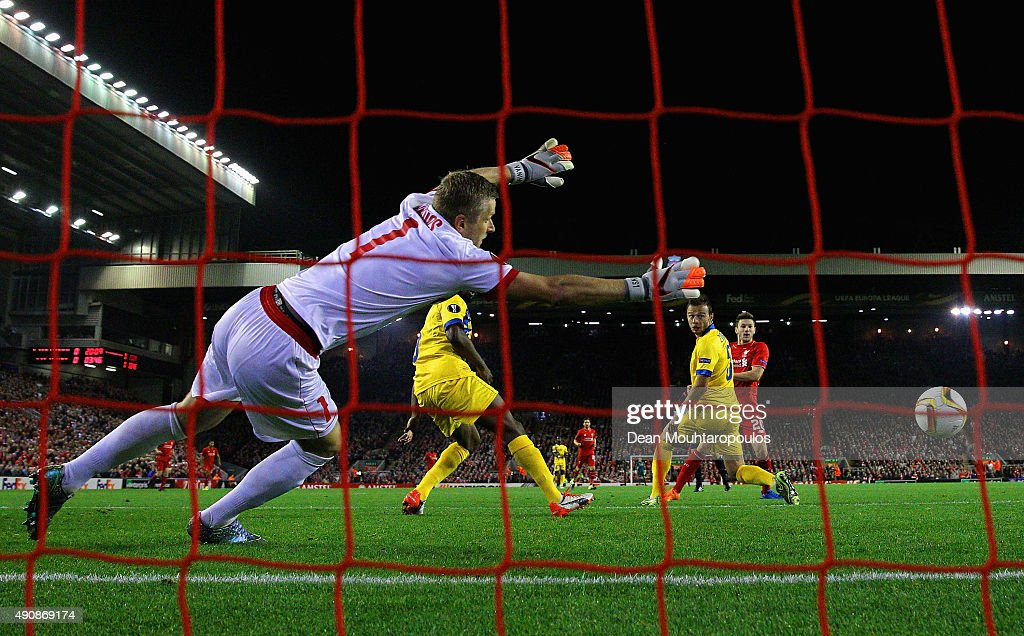 Adam Lallana of Liverpool scores the opening goal past Andris Vanins of FC Sion during the UEFA Europa League group B match between Liverpool FC and FC Sion at Anfield on October 1, 2015 in Liverpool, United Kingdom.