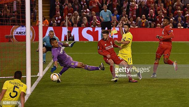 Adam Lallana of Liverpool scores the thrid goal during the UEFA Europa League Semi Final Second Leg match between Liverpool and Villarreal CF at...