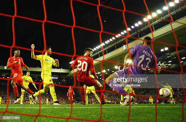 Adam Lallana of Liverpool scores their third goal past goalkeeper Alphonse Areola of Villarreal during the UEFA Europa League semi final second leg...