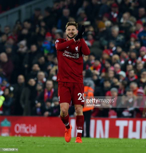 Adam Lallana of Liverpool shows his appreciation to the fans at the end of the Premier League match between Liverpool FC and Crystal Palace at...