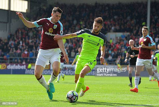 Adam Lallana of Liverpool takes on Michael Keane of Burnley during the Premier League match between Burnley FC and Liverpool FC at Turf Moor on...