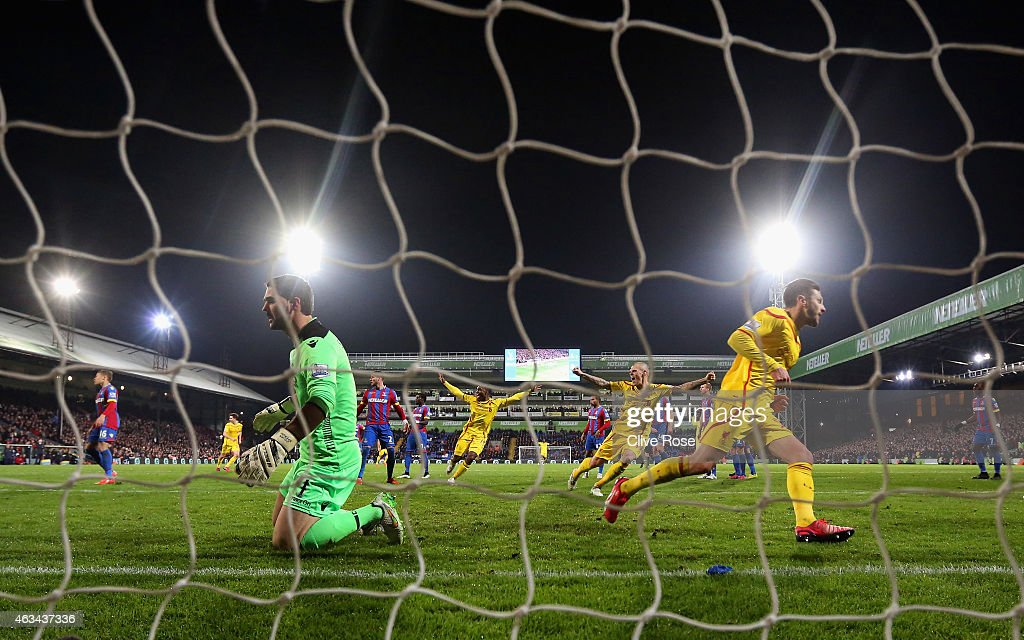 Adam Lallana of Liverpool turns to celebrate after scoring the second goal past Julian Speroni of Crystal Palace during the FA Cup fifth round match between Crystal Palace and Liverpool at Selhurst Park on February 14, 2015 in London, England.