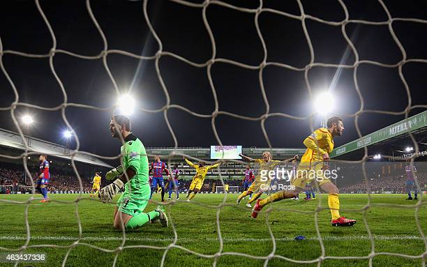 Adam Lallana of Liverpool turns to celebrate after scoring the second goal past Julian Speroni of Crystal Palace during the FA Cup fifth round match...