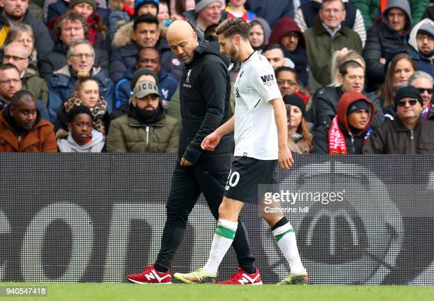 Adam Lallana of Liverpool walks off injured during the Premier League match between Crystal Palace and Liverpool at Selhurst Park on March 31 2018 in...