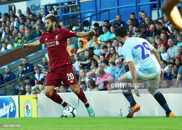 Adam Lallana of Liverpool with Corry Evans of Blackburn during the PreSeason Friendly match between Liverpool and Blackburn at Liverpool Park on July...