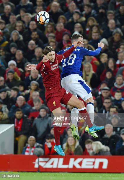 Adam Lallana of Liverpool with James McCarthy of Everton during The Emirates FA Cup Third Round match between Liverpool and Everton at Anfield on...