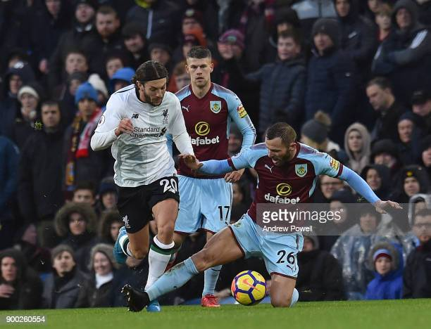 Adam Lallana of Liverpool with Phil Bardsley of Burnley uring the Premier League match between Burnley and Liverpool at Turf Moor on January 1 2018...