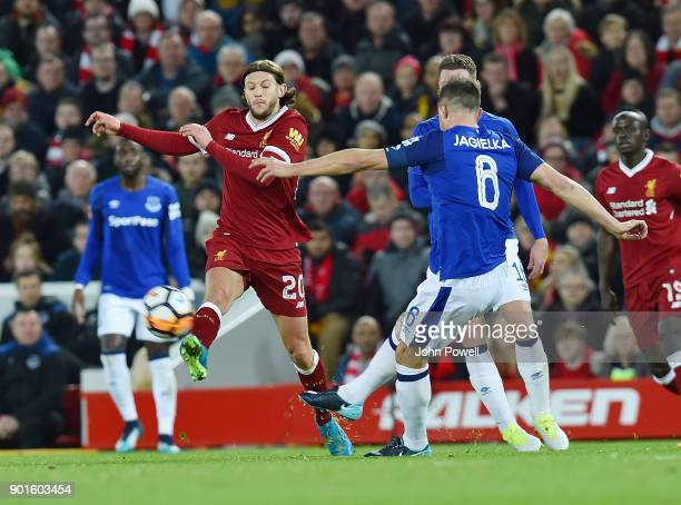 Adam Lallana of Liverpool with Phil Jagielka of Everton during The Emirates FA Cup Third Round match between Liverpool and Everton at Anfield on...