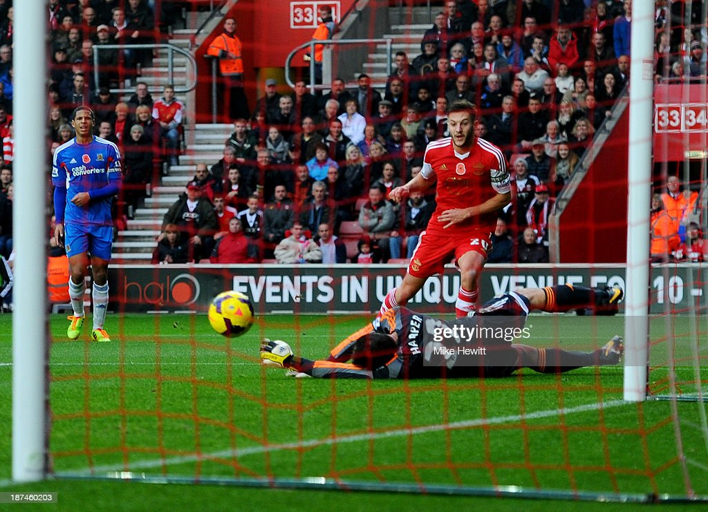 Adam Lallana of Southampton beats Steve Harper of Hull City to score their third goal during the Barclays Premier League match between Southampton and Hull City at St Mary's Stadium on November 9, 2013 in Southampton, England.