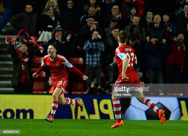 Adam Lallana of Southampton celebrates scoring their second goal during the Barclays Premier League match between Southampton and Arsenal at St...