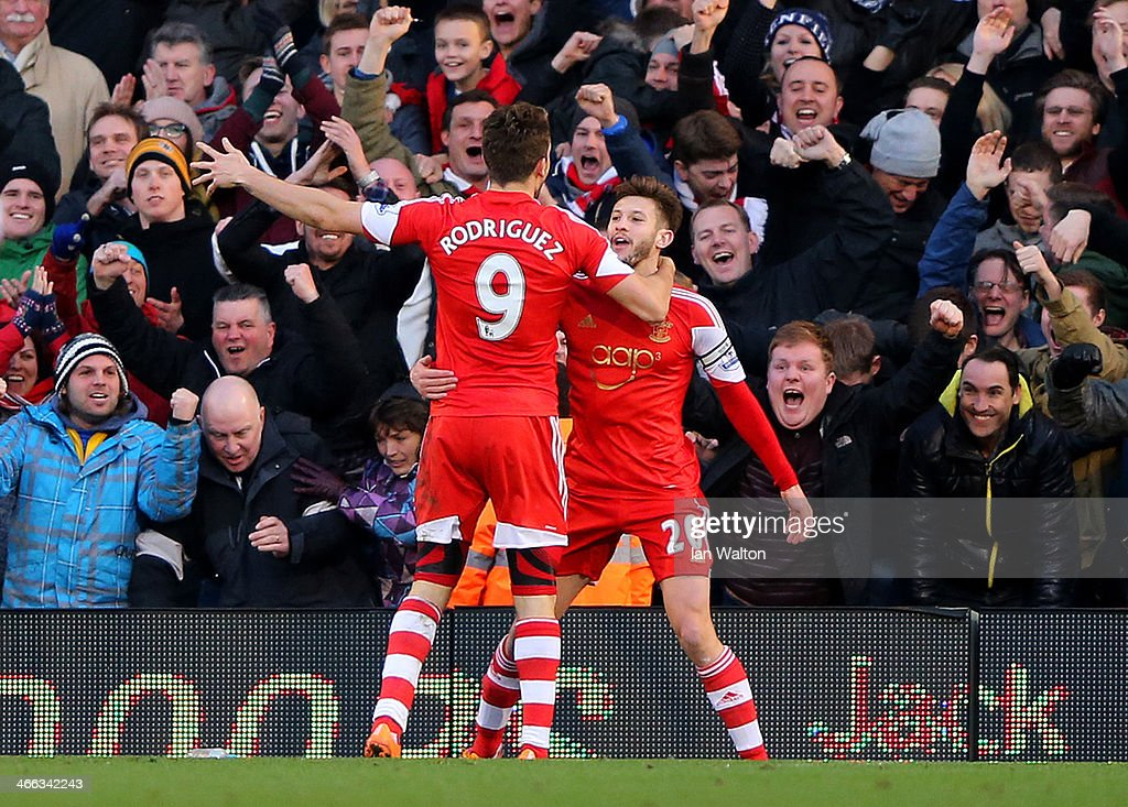 Adam Lallana (R) of Southampton celebrates with team-mate Jay Rodriguez of Southampton after scoring the opening goal during the Barclays Premier League match between Fulham and Southampton at Craven Cottage on February 1, 2014 in London, England.